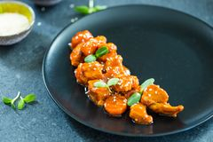 Chinese Chicken in Sweet and Sour Sauce with Sesame Seeds, Horizontal View Royalty Free Stock Photos