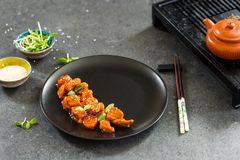 Chinese Chicken in Sweet and Sour Sauce with Sesame Seeds, Horizontal View stock photos