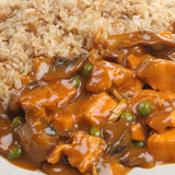 Chinese Chicken Takeaway. Chinese chicken curry with egg fried rice Stock Image