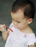 Chinese child  blowing bubbles Royalty Free Stock Images