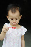 Chinese child  blowing bubbles Stock Photo