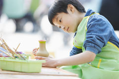Chinese child dedicated makes handwork  Royalty Free Stock Image
