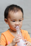 Chinese child drink water Stock Photography