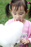 Chinese child eating cotton candy Stock Images