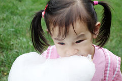 Chinese child eating cotton candy Royalty Free Stock Image