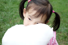 Chinese child eating cotton candy Royalty Free Stock Photos