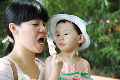 Chinese child eating ice cream with mother Stock Image