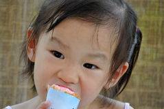 Chinese child eating ice cream Stock Image