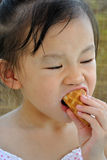 Chinese child eating ice cream Stock Photo