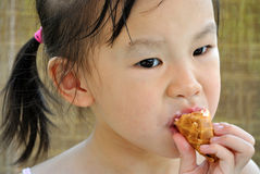 Chinese child eating ice cream Royalty Free Stock Photos