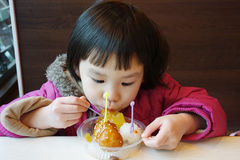 Chinese child eating snack Stock Photography