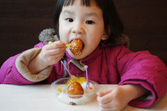 Chinese child eating snacks Stock Photography