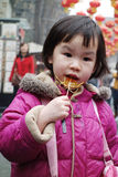 Chinese child eating sugar Stock Photos