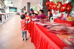 A Chinese child is enjoying the joy of the Chinese New Year. The Chinese New Year is the most traditional festival for Chinese people. The reunion of the royalty free stock photography