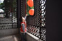 A Chinese child is enjoying the joy of the Chinese New Year. The Chinese New Year is the most traditional festival for Chinese people. The reunion of the stock photos
