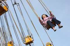 Chinese child with flying chair Stock Images