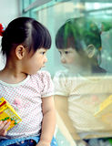 Chinese child Looking in the mirror Stock Image