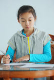 Chinese child makes homework Stock Photo