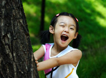 Chinese child making faces. Chinese little girl making faces Stock Image