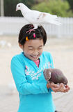 Chinese child with pigeon Stock Images