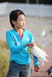 Chinese child with pigeon Royalty Free Stock Photo