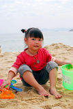 Chinese child Playing on the beach Royalty Free Stock Photography