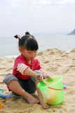 Chinese child Playing on the beach Stock Photo