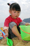 Chinese child Playing on the beach Stock Image