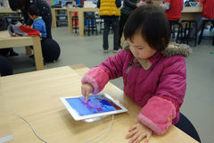 Chinese child playing ipad Royalty Free Stock Photos