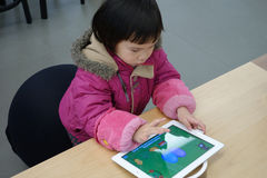 Chinese child playing ipad Stock Photos