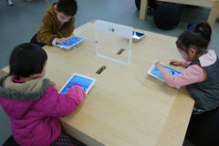 Chinese child playing ipad stock photos