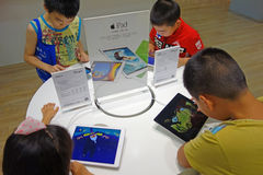 Chinese child playing ipad Royalty Free Stock Photo