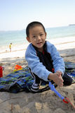 Chinese child playing sand Royalty Free Stock Image
