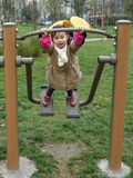Chinese child is playing on the swings royalty free stock photos