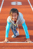 Chinese child prepares to start running. The chinese little girl prepares to start running Stock Images