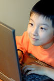 Chinese child use computer Stock Photos