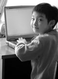 chinese child use laptop  Royalty Free Stock Photos