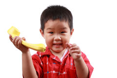 Chinese children. Girl playing phone with white background,a happy lovely baby royalty free stock photography