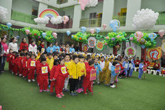 Chinese Children with balloons in kindergarten. Children with balloons in kindergarten Royalty Free Stock Image