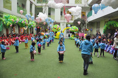 Chinese Children with balloons in kindergarten. Children with balloons in kindergarten Royalty Free Stock Photography