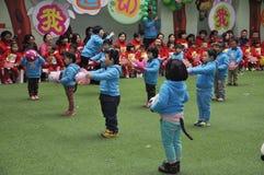 Chinese Children Dancing in kindergarten. Children with balloons in kindergarten stock photos