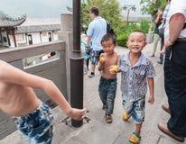 Chinese children eat fruit Royalty Free Stock Photos
