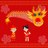 Chinese children holding the dragon Royalty Free Stock Photos