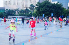 Chinese children learn roller skating sports Royalty Free Stock Photo