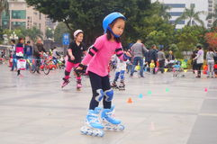 Chinese children learn roller skating on Sunday Stock Image