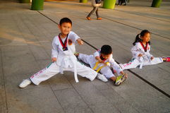 Chinese children learning Taekwondo. Weekend, learn Chinese children Taekwondo, out of the training hall. In Shenzhen, china Stock Images
