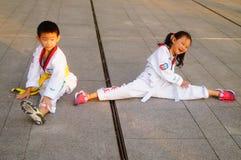 Chinese children learning Taekwondo. Weekend, learn Chinese children Taekwondo, out of the training hall. In Shenzhen, china Royalty Free Stock Photos
