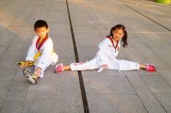 Chinese children learning Taekwondo. Weekend, learn Chinese children Taekwondo, out of the training hall. In Shenzhen, china Royalty Free Stock Images