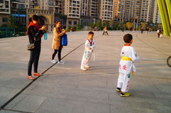 Chinese children learning Taekwondo. Weekend, learn Chinese children Taekwondo, out of the training hall. In Shenzhen, china Royalty Free Stock Photography