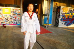 Chinese children learning Taekwondo. Weekend, learn Chinese children Taekwondo, out of the training hall. In Shenzhen, china Stock Photography